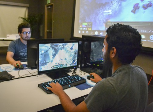 Battling each other in an intense game of League of Legends, junior biology major Edward Espinoza and sophomore mathematics major Henry Perez showcase their gamer skills at the ULV Gamers Guild League of Legends Tournament on Oct. 15. Held at Campus Center Ballroom B, members were invited to compete to become tournament champion. League of Legends is a multiplayer fantasy computer game where players compete in battlefields to destroy the opposing team's base, known as a nexus. / photo by Karla Rendon