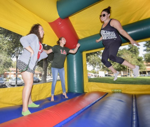 Iota Delta sorority sisters – sophomore chemistry major Lupe Lara, sophomore political science major Hannah Bauer and senior liberal studies major Katie Lewis – jump for cystic fibrosis awareness during the 24-hour jump-a-thon Oct. 28 in Sneaky Park. Students entered raffles to win clothing and all money raised went to the Cystic Fibrosis Foundation.  / photo by Nanor Zinzalian