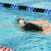 The La Verne swimming and diving team started off the 2015-16 season with a splash at Saturday at Haldeman Pool at Pomona-Pitzer. Sophomore Mary Hanna competes in the women's 3x100-yard backstroke relay, with teammates junior Krislynn Cha and sophomore Rachel Miyoga. The three swimmers finished sixth collectively with a time of 3:15.56. / photo by Terrence Lewis