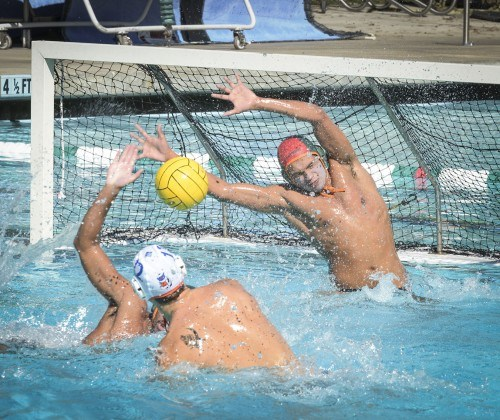 Leopards freshman goalkeeper Ian Hernandez denies a goal by Pomona-Pitzer junior attacker James Baker, after a break away halfway through the fourth quarter at their match Saturday at the La Verne Aquatics Center. Hernandez was able to block six shots in the fourth quarter alone, but La Verne could not get out of its deficit, losing to the Sagehens, 11-5./ photo by Daniel Torres