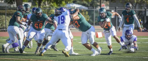 La Verne senior running back Travis Sparks-Jackson rushes for 9 yards of 159 yards in the game, giving him the school career record of 2,891 yards. Sparks-Jackson broke the previous all-time record of 2,844 set by running back Matthew Biggers in 2013./ Photo by Daniel Torres