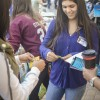 Prospective student Alyssa Perez visits the Japanese club booth and learns how to make an origami crane at the Preview Day club fair Nov. 21 at the Quad. The University hosts Preview Day each year in order for prospective students to familiarize themselves with the University and to know about the different clubs and departments on campus./ photo by Sarah Vander Zon
