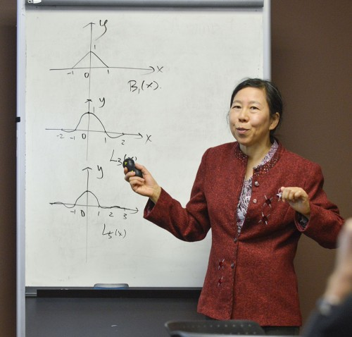 Professor of Mathematics Xiaoyan Liu discusses numerical methods for solving systems of integral equations with cardinal splines. Liu spoke in the Presidents' Dining Room Tuesday for the weekly faculty lecture sponsored by the La Verne Academy. / photo by Noel Cabrera