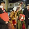 Carolers Don Lucas, Wendee Bresee, Afton Hedley, and Eddie Eng walk around the Claremont Village on Dec. 4, singing Christmas carols to people attending the Village Holiday Promenade. People from the local area attended the holiday event at the Claremont Depot to watch local bands perform and participate in a holiday toy drive. Attendees were also able to visit with Santa and Mrs. Claus at City Hall as well as watch the annual tree lighting ceremony at the Depot. / photo by Sarah Vander Zon