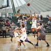 Junior La Verne guard Hakim Arnold makes a jumper over senior Whittier guards Eric Jennings and Louis Kurlhara Saturday at Frantz Athletic Court. Arnold finished the game with 14 points. In the final seconds of the game, junior guard Khaneal Mason made up a layup to give La Verne the lead. The Leopards preyed on the Poets, 91-89./ photo by Meghan Attaway