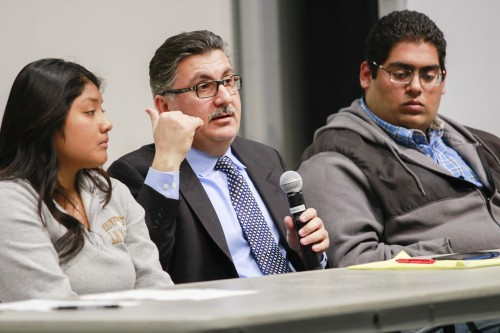 """Taif Kaissi, co-founder of Medical Network Devoted to Service, a nonprofit mental health service for the Muslim community, recalls the discrimination his family faced after 9/11 at """"Different Faces, Same Fears,"""" a discussion panel, Feb. 19 in LaFetra Hall. He was joined by freshman business administration major Maribel Hernandez and alumnus Tahil Sharma./ photo by Kendra Craighead"""