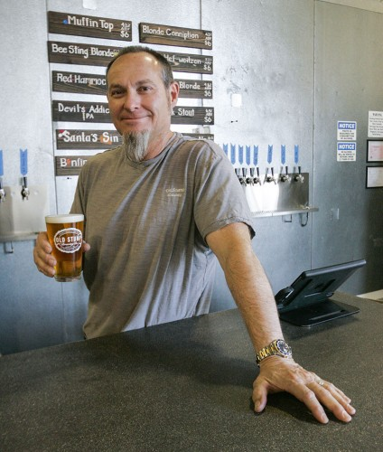 Master brewer Harald Gallob, co-owner of Old Stump Brewing Co., shows off a glass of his Red Hammock craft beer fresh from the tap. The brewery is located at Bonita Avenue and Metropolitan Place in Pomona. For more information, visit oldstumpbrewery.com. / Photo by Terrence Lewis