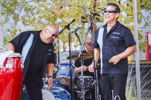 "Jose ""Chepe"" Cuadra and Gene Chavez perform with their eight-member band Cold Duck to celebrate the opening of the Gold Line Foothill Extension Saturday in Arcadia. Cuadra assembled the band in 1969 and is the lead vocalist but also plays trumpet and percussion. Chavez sings and plays the flugelhorn and trumpet. Cold Duck is a Los Angeles band that performs dance music. / photo by Jerri White"
