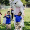 Twin brothers Jeremy and Trevor Clarke, 6, pose for a photograph with the Easter Bunny after the Easter egg hunt Saturday at Las Flores Park. Jeremy found one of the special Easter eggs and won a prize basket for the first time. His family has been participating in the event for years. / photo by Donna Martinez