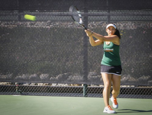 La Verne freshman Savanah Goode strikes back from a serve by Chapman junior Madeline Saunders Friday at the Claremont Club. The Leopards pounced the Panthers 7-2./ photo by Kathleen Arellano