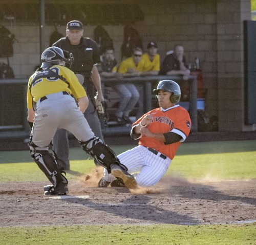 La Verne freshman left fielder Chris Ligot scores on a double by senior center fielder Nolan Henley in the eighth inning of Friday's game against Pacific Lutheran at Ben Hines Field. It was the last run the Leopards scored before losing to the Lutes, 14-6./ photo by Jerri White