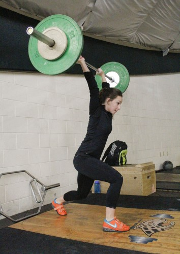 "McCann ""snatches"" 50 kilograms in the weight training room where she prepares for weight lifting competitions. McCann participated in the St. Patrick's Day weight lifting Championships in March where she qualified to compete in nationals over the Summer."