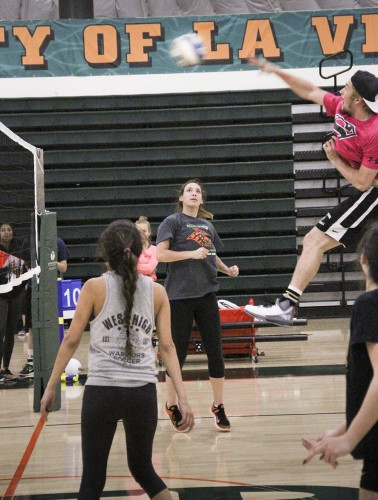 Connor Head, sophomore business administration major, hits the ball over the net for his team. The Sigma Kappa team won its game against the Goon Squad. The close game ended in overtime. / photo by Ashlyn Hulin