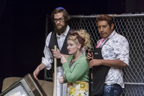 """Alex Freitas, senior theater major; Courtney Clark, freshman theater; and Aaron Avalos, senior history major, perform as the vecinos (neighbors) in """"Electricidad"""" at Dailey Theatre. The play, a contemporary story on the gang culture in East Los Angeles, was written by Luis Alfaro. The production is directed by artist-in-residence Alma Martinez. """"Electricidad"""" will run through Sunday. / photo by Donna Martinez"""