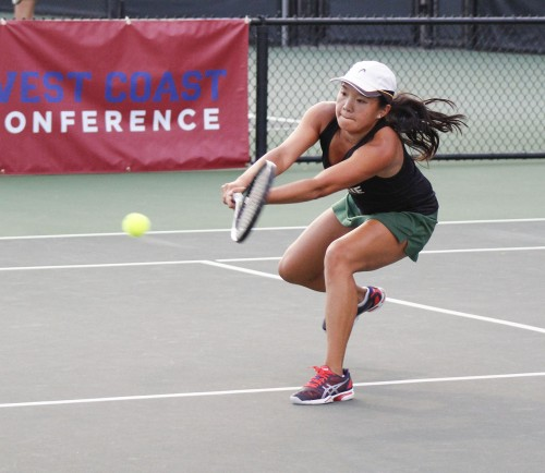 Leopards' sophomore Janae Chinn hits a backhand in her first singles match against No. 4 Claremont-Mudd-Scripps April 28 at the Biszantz Family Tennis Center. La Verne was swept, 9-0, to the Athenas./ photo by Brooke Grasso
