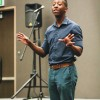 University of La Verne alumnus Myron Woods performs spoken word poetry April 28 in the Center Campus Ballroom for Art Around the World. The event, sponsored by the Campus Activities Board, celebrated international cultures by providing different kinds of food while students expressed themselves through dance, poetry and songs. / photo by Bailey Maguire