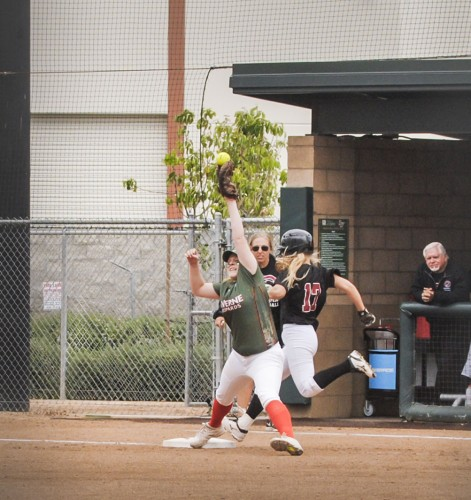 La Verne junior first baseman Alexis Schiff barely catches the ball for an out at first base in the top of the third inning against the Chapman Panthers Saturday at Campus West. The Leopards won the 2016 Southern California Intercollegiate Athletic Conference championship on senior day, 3-2, in game one of the doubleheader and 4-2 in game two. / photo by Nadira Fatah