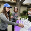 Myranda Garcia and Caitlin Pallotta, senior public relations majors from the University of La Verne, raise awareness and donations for Alzheimer's disease research at their senior project event, Memories Matter Walk-A-Thon, Saturday at Hillcrest Senior Living Community. The event featured live music since Garcia and Pallotta said research has shown music can help slow a patient's memory loss. The raffle donations would go toward purchasing iPods for patients with Alzheimer's disease at Hillcrest. / photo by Kendra Craighead