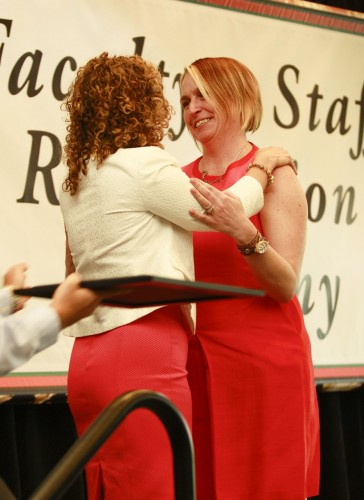 Erin Gratz, librarian, accepts the Ellsworth Johnson Faculty Service Award from President Devorah Lieberman during the 2016 Faculty and Staff Recognition Ceremony Friday in the Campus Center Ballroom. The annual ceremony honored faculty members and employees who received awards in service and teaching at the University. / photo by Autumn Simon