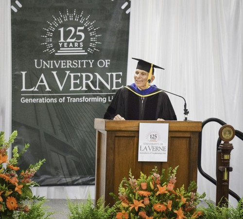 Professor of Business Administration and Economics Ahmed Ispahani delivers the keynote speech at the 125th anniversary Convocation ceremony Aug. 31. Ispahani has been teaching at La Verne since 1964. He spoke about his educational journey at the University of Southern California, from where he took his first teaching job at the University of La Verne during the last year of graduate school. La Verne was not his first choice as a career path, but after a year he fell in love with the environment, culture, community and heritage, he told the audience. / photo by Meghan Attaway
