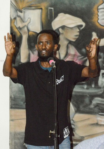 "David ""Judah 1"" Oliver shares his life stories and experiences through poetry Sept. 1 at the dA Center for the Arts's Open Mic. Oliver, along with others, started Open Mic as a way to build a new community to transcend the social issues of today. Open Mic occurs every first Thursday of the month at the dA Center for the Arts at 252 South Main Street in Pomona. / photo by Janelle Kluz"