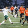 La Verne junior midfielder Justin Funes sends the ball upfield past Caltech senior midfielder Dave Luo and senior defender Kevin Gao during the first half of the game Saturday at Ortmayer Stadium. The Leopards went on to crush the Beavers, 5-1. / photo by Amanda Duvall