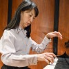"""Playing a segment of """"Gardens under the Rain"""" by Claude Debussy, Marge Wei Chen, Senior Adjunct Professor in the Music Department, releases her nervous energy as she performs on stage in the Morgan Auditorium. Chen started playing the piano at age 10. At 15 years old she moved from Taiwan to Germany and was one of the youngest pianists to play at the Royal Conservatory of Brussels. In 2000, Chen was in a car crash from which doctors did not expect her to recover. Today, Chen has earned 2 masters degrees in piano and music theory and a doctorate in conducting."""