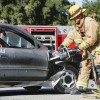 Firefighter Larry Campbell demonstrates a vehicle extrication using the Jaws of Life in front of the La Verne Fire Department Saturday. This demonstration, along with others from both the police and fire departments, was part of the Public Safety Open House. Visitors of all ages took tours of both the La Verne fire and police departments, conducted by RSVP, or the Retired and Senior Volunteers, and enjoyed a barbecue sponsored by members of the Police and Fire Association. / photo by Amanda Duvall