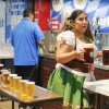 Amanda Jimenez, a bartender at the Spatan booth, serves Spatan Oktoberfest, a popular, savory beer from Munich, at Oktoberfest at the Fairplex Saturday. The festival includes games, live music, a dance hall, German food and booths. The festival is going on every Friday and Saturday from 6 p.m. to midnight this month, through Oct. 29. / photo by Gabriella Chikhani