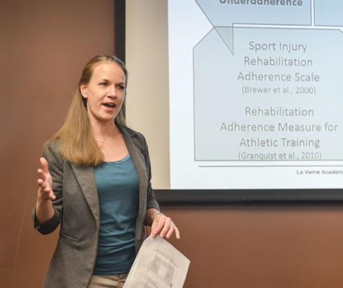 "Associate Professor of Kinesiology Megan Granquist talks about the psychological factors of athletic performance Tuesday in the President's Dining Room. Granquist shared information from her book, ""Psychosocial Strategies for Athletic Training,"" published in 2015 and focuses on stress management techniques and methods by which she helps patients work with stress and coping strategies. / photo by Sarah Vander Zon"