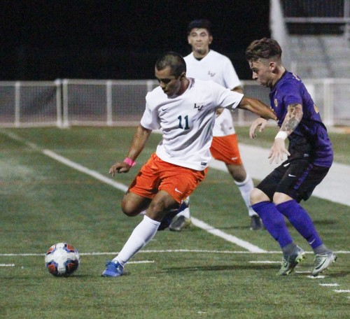 La Verne junior midfielder Javier Jasso defends the ball against Cal Lutheran junior midfielder Nico Sabbattella during the final minutes of the first half Monday at Ortmayer Stadium. The Regals scored the only goal of the game, beating the Leopards, 1-0. / photo by Berenice Gonzalez