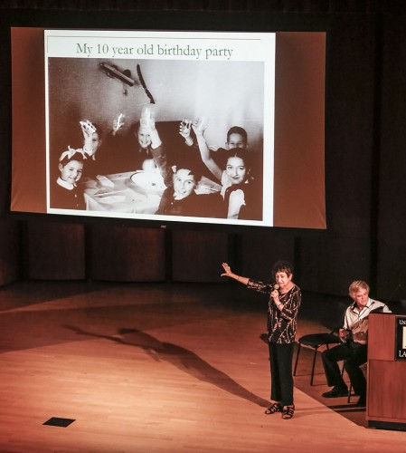 Gabriella Karin, a child survivor of the Holocaust, shows a photo of herself at her 10th birthday party. Of all the children pictured, she was the only one who survived. She was accompanied by fellow Holocaust survivor Robert Germinder at the Child Survivors of the Holocaust lecture in Morgan Auditorium Tuesday. / photo by Amanda Duvall