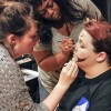 Sophomore theater major Ashley Weaver and freshman theater major Jordan Nelson practice make-up techniques on freshman theater major Mallorie Johnson during the Cabaret Series' Monster Bootcamp event Tuesday. / photo by Donna Martinez
