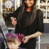 Rose Cutter, 4, receives a glittery, bright magenta Halloween-inspired hairdo by Kut Haus stylist Andrea Alarcon at the 35th annual Village Venture Arts and Crafts Faire Saturday in the Claremont Village. The fair showcased local art, food, crafts and apparel. / photo by Kathleen Arellano