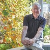 Bill Neill relaxes on the porch of his downtown La Verne home in 2008. He and his wife Charlotte moved into the house on Third Street when they returned to the University of La Verne in 1988. / file photo by Sheila Del Castillo