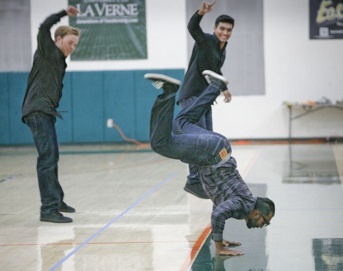 Sophomore kinesiology major Ishwar Persuad, freshman criminology major Brenden Bergen and junior kinesiology major Isaiah Cruz show their moves in a lip-sync battle during Moonlight Madness Oct. 27 at the Frantz Athletic Court. Hosted by Campus Activities Board and LeoFM, Moonlight Madness introduced the men's and women's basketball teams and kicked off the basketball season. La Verne athletes played the basketball games Knockout and the Three-Point Challenge. / photo by Taylor Bolanos