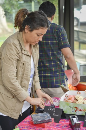 Law student Ashley Garay-Bowman sets up a booth to celebrate Día De Los Muertos Monday at the University of La Verne College of Law campus in Ontario. The Latino Law Student Association celebrated the Day of the Dead with traditional Mexican hot chocolate and bread. They took donations to fund more events and will host a speed mentoring session for law students. The association's first speed mentoring session is scheduled for 6 p.m. Monday at the College of Law. / photo by Sarah Vander Zon