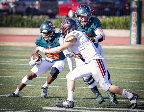 Sophomore offensive lineman Tyler Baeza clears the field of Sagehens as sophomore wide receiver Brandon Long covers ground in the fourth quarter Saturday at Ortmayer Stadium. Although the Leopards led most of the game, the Sagehens flew away with a 21-20 triumph after scoring a final touchdown in the fourth quarter. La Verne is now 1-7 overall and 1-5 in SCIAC play. / photo by Michael Savall