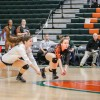 Sophomore defensive specialists Tiffany Mancuso and Sarah Yauchzee attempt to dig the ball during the fourth set of the Women's Volleyball Championship hosted at the University of Texas at Dallas on Friday. / photo by Amanda Duvall