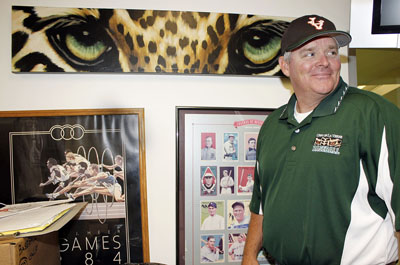 """In his ninth season of coaching for the La Verne Leopards baseball program, Scott Winterburn reached his 200th career win on April 4 against Caltech in a doubleheader at Ben Hines Field. When asked about the Sara and Michael Abraham Campus Center behind Ben Hines Field he said """"I love it!"""" and expressed minor regret over the planned relocation of the baseball field. / photo by Rafael Anguiano"""