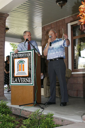 University of La Verne President Stephen Morgan enjoys a moment with J. Clair Hanawalt at the re-opening ceremony for the Hanawalt House on Wednesday. The House was originally built in 1908 and served as the home of W.C. Hanawalt, the fifth president of Lordsburg College. Hanawalt House will serve as a meeting area as well as the offices for alumni relations and special events. / photo by Steven Bier