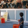 Nicholas Kienver, 2, of La Verne, played along with Steve Biondo's West African Drum Ensemble Saturday at the Kid's Music Club event in Founders Auditorium. The ensemble, taught by Biondo, teaches students traditional West African rhythms dating back to the 12th century. The Kids Music Club is an ongoing series of free educational concerts sponsored by the music department, offering children a chance to explore the thrill of live music. / photo by Rafael Anguiano