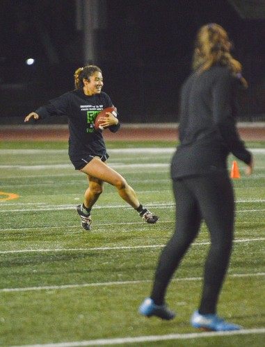 Sophomore athletic training major Ariana Dowell gains 20 yards in the Powderpuff football game Monday at Ortmayer Stadium. The game was hosted by Residence Hall Association. Women played against the men in the 30-minute game, losing 28-7. / photo by Janelle Kluz