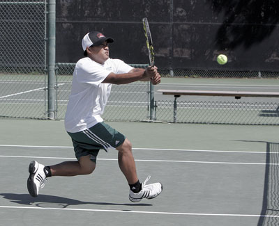 Senior Adrian Laygo of ULV charges to return a volley against Biola. Laygo and freshmen Mark Rivas provided the only point with their doubles match victory. The match took place Wednesday at the Claremont Club. The Eagles routed the Leopards, 8-1. / photo by Stephanie Arellanes
