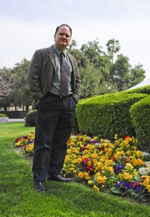 "Richard Gelm, who published his first book, ""Politics and Religious Authority"" in 1994, has been teaching in the history and political science department since 1991. Gelm, a self-described San Diego Padres fan, has served as department chair since 1997. / photo by Sherazad Shaikh"