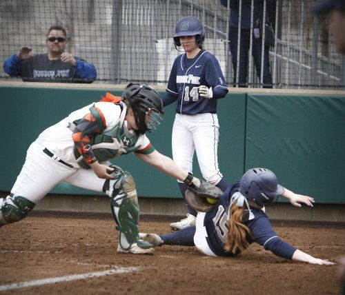 La Verne junior catcher Angelica DeAngelo is late to a fifth inning tag against George Fox first baseman junior Alex Parker Friday. George Fox freshman pinch runner Madelynn Vallejo scored ahead of Parker for the Bruins. The Leopards lost in Game 1, 7-5. La Verne will face Antelope Valley in a doubleheader starting at 1 p.m. Friday at Campus West./Photo by Tyler Deacy