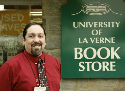 "The new store manager for the University of La Verne Bookstore, Derek Dioses is glad to be back in La Verne. Dioses has worked for the Follett company for more than 20 years. Dioses began his career at Chapman University and worked at two different stores there. He then briefly moved here to the ULV Bookstore in 1991, moved on to Cal State Dominguez Hills, followed by Cal State Northridge. ""It feels like I've completed a full circle and now I'm back home,"" Dioses said. / photo by Stephanie Arellanes"