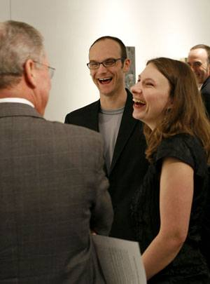 "Artist Daina Higgins shares a light moment with President Stephen Morgan and Dion Johnson, director of galleries. Associate Professor of Art Keith Lord picks up on the conversation. Higgins traveled from New York to take part in a reception for her and Liat Yossifor, a painter from Los Angeles. The exhibition, ""To Here Knows When,"" was curated and installed by Johnson. / photo by Steven Bier"