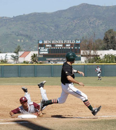 In the first game against the Schreiner Mountaineers, Schreiner sophomore infielder Tomas Garcia is late for the tag on La Verne senior infielder Anthony Gonzalez who singles to first base at the bottom of the second inning. The Leopards topped the Mountaineers in the doubleheader, winning both games 6-1 and 16-7 at Ben Hines Field March 12. / photo by Hannah Burton