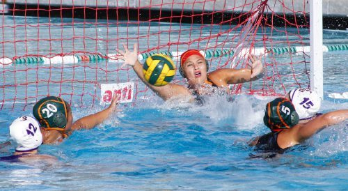 La Verne senior goalkeeper Cambria Serrano blocks a shot in the third quarter of the game against Cal Lutheran March 22 at the La Verne Aquatic Center. Junior utility Hayley Cates and senior attacker Ardelle Aquino defend against Cal Lutheran freshmen center Victoria Rose Meek and attacker Christin Hirn, as the foursome converges on the net. The Leopards drowned the Regals 11-9. / photo by Tyler Deacy